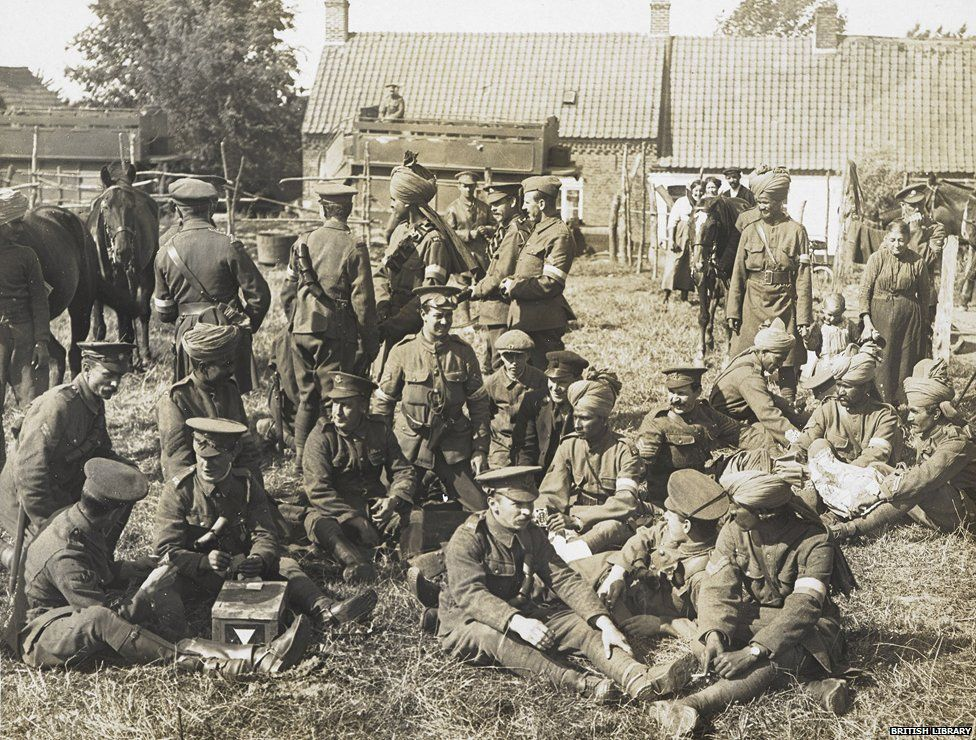English and Indian soldiers of the Signal Troop of the Lucknow Cavalry Brigade relaxing in a farmyard at Brigade Headquarters, 28 July 1915,