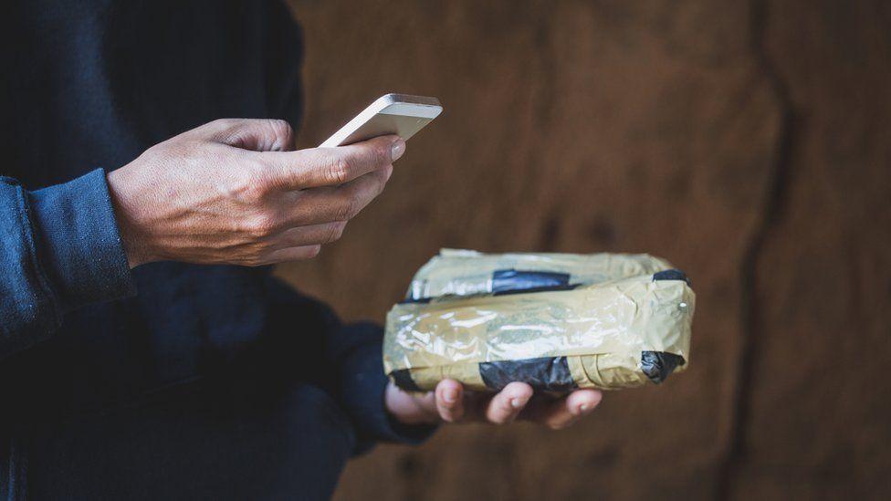 Drug dealer using a phone