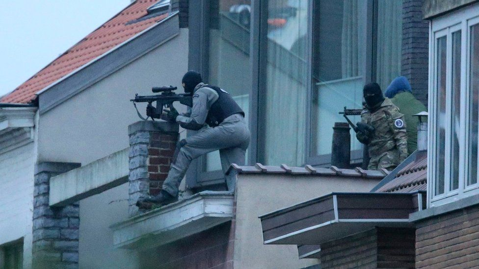 Security forces at the scene of a shoot-out in Brussels