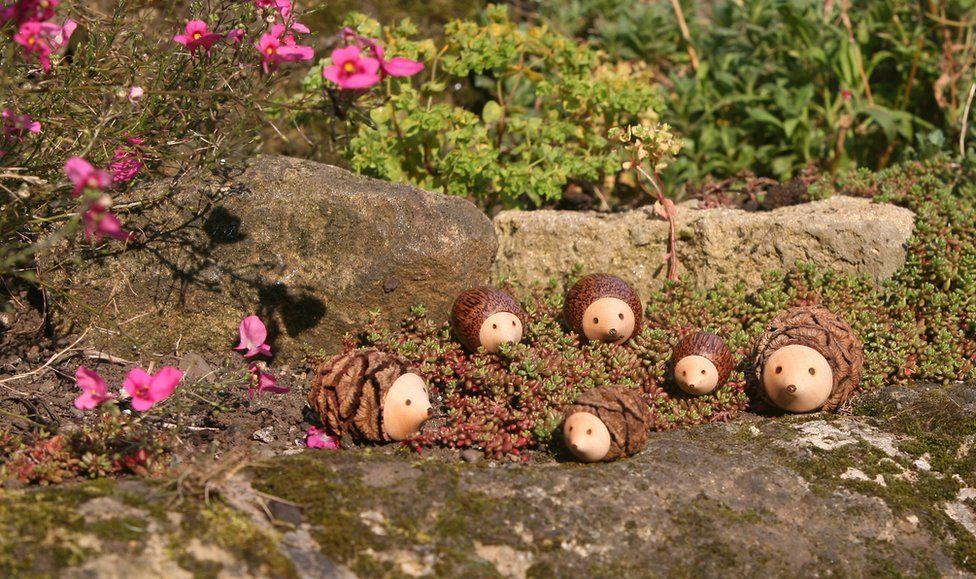 Small sculptures arranged in garden