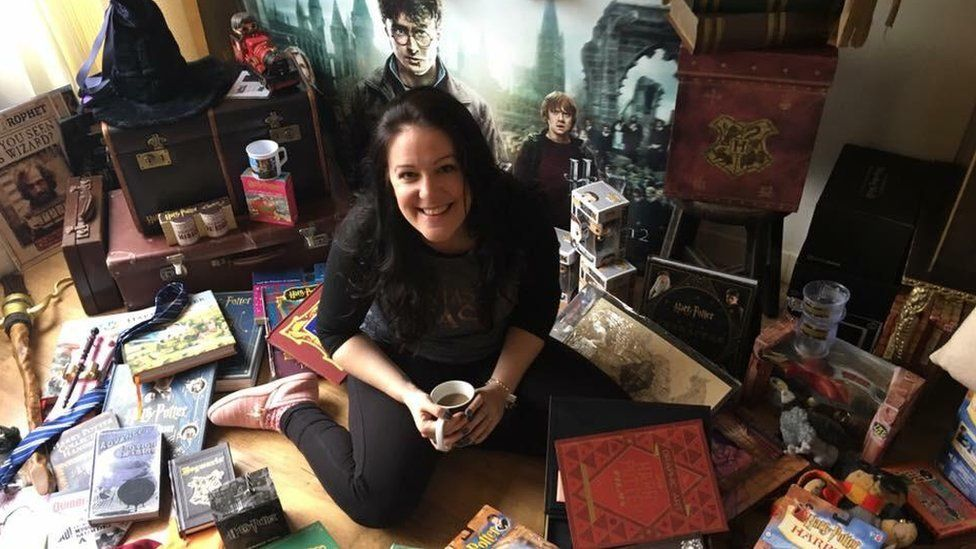 Victoria Maclean in font of some of her Harry Potter memorabilia