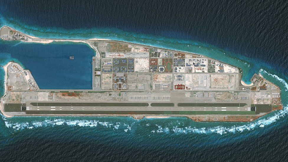 An overview satellite image shows construction by the Chinese on the Firey Cross Reef