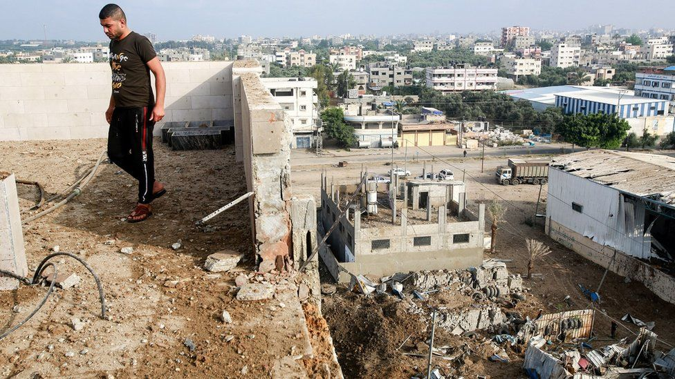 Man stands by rubble in Gaza
