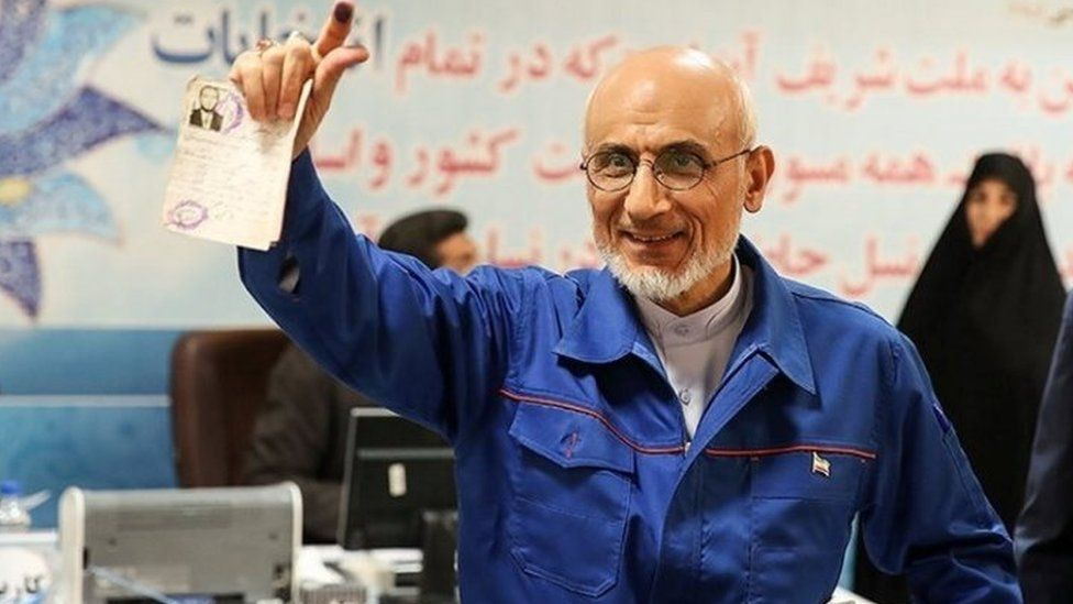Mostafa Mirsalim holds his document as he registers his candidacy for presidential elections at the Interior Ministry in Tehran (11 April 2017