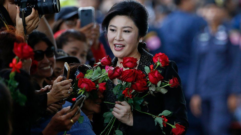 """Former Thai prime minister Yingluck Shinawatra is greeted by supporters as she arrives to deliver closing statements in her trial for alleged criminal negligence over her government's rice-pledging scheme at the Supreme Court""""s Criminal Division for Persons Holding Political Positions in Bangkok, Thailand, 01 August 2017."""