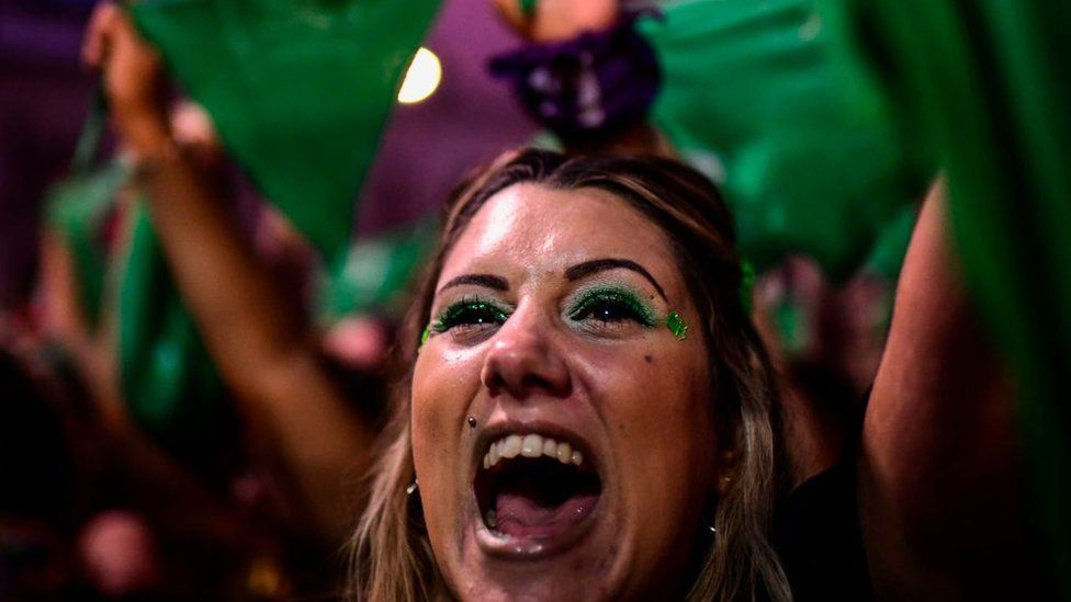 Thousands of women hold green scarves demanding the the decriminalization of abortion as they protest at Argentina's National Congress in Buenos Aires