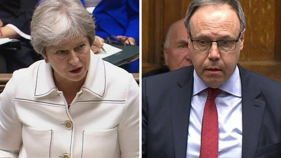 Theresa May and Nigel Dodds in the House of Commons