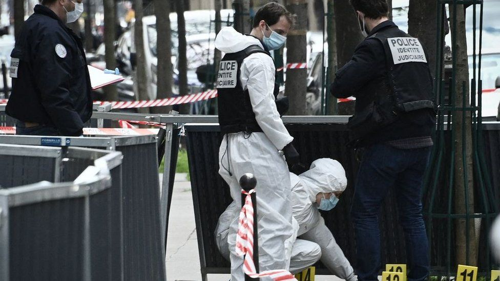 Police investigate the scene of a shooting outside a Paris hospital on 12 April 2021