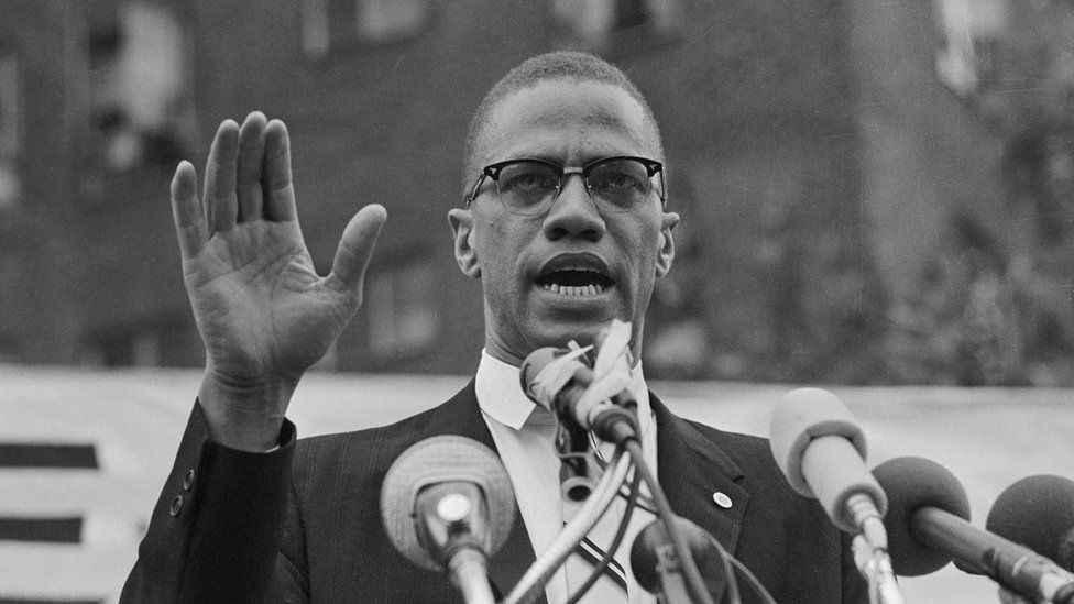 Malcolm X speaks at a rally. File photo