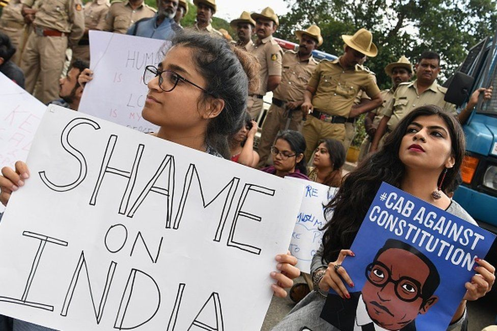 Students and activists hold placards and shout slogans during a protest against the Indian government's Citizenship Amendment Bill (CAB) in in Bangalore on December 16, 2019