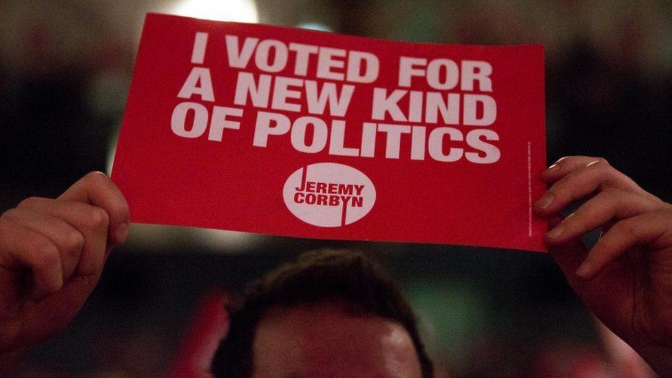 Jeremy Corbyn supporter holds up a sign