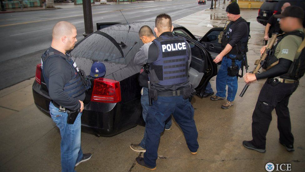 US Immigration and Customs Enforcement officers detain a suspect in Los Angeles