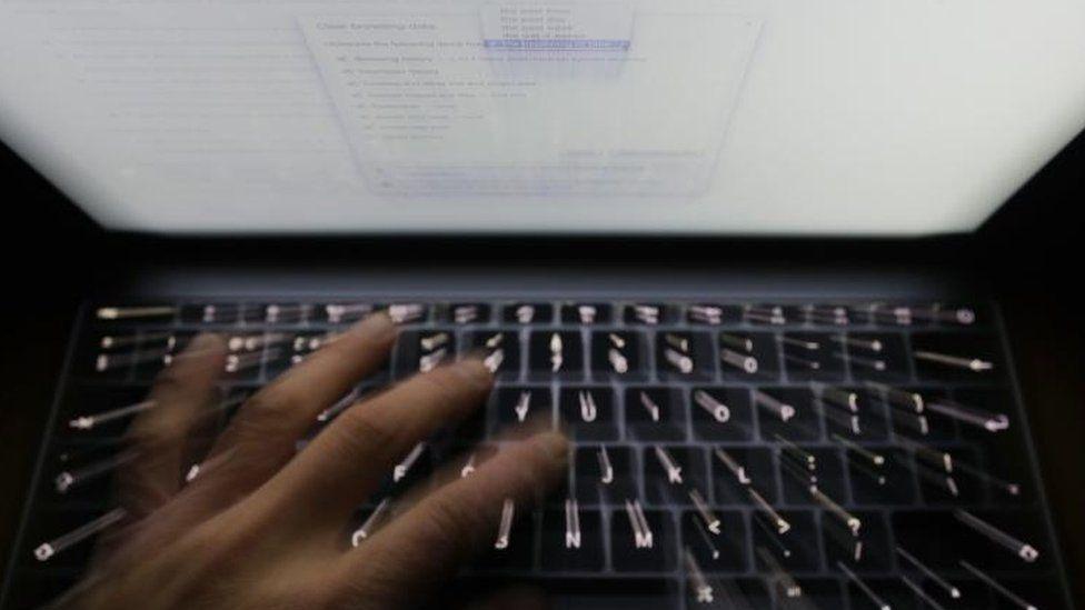 Hand on computer