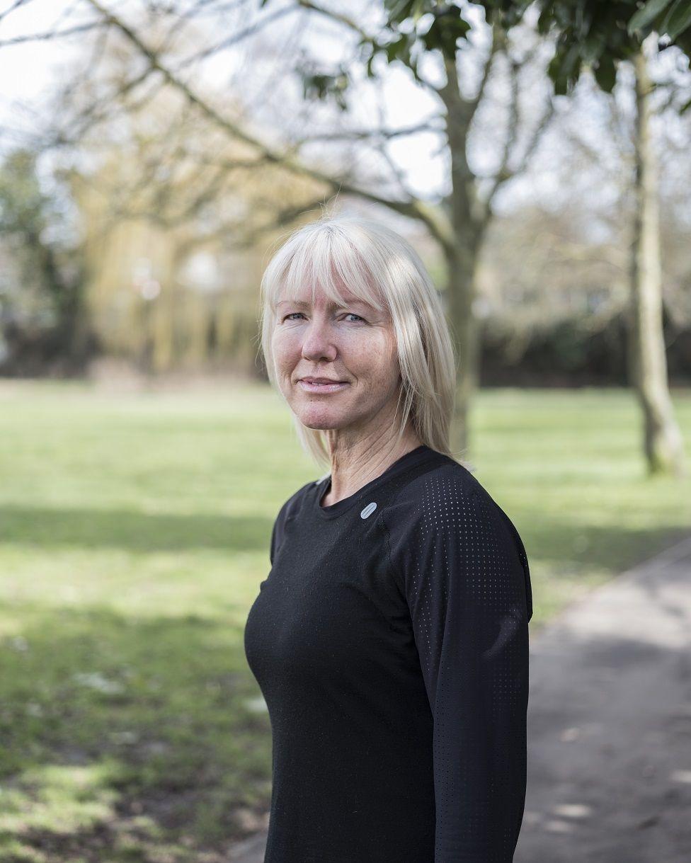 Photo of Karen Jones at the park in running gear