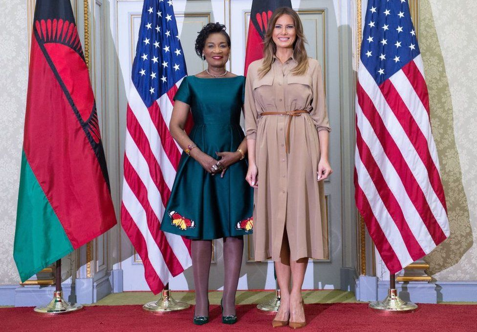 US First Lady Melania Trump and the First Lady of Malawi Gertrude Maseko pose for a photograph at the State House in Lilongwe, on October 4, 2018, as she pays a one day visit to the country as part of her solo tour of Africa promoting her children's welfare programme.