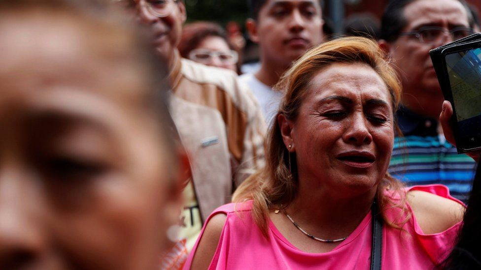 A woman reacts as she sings one of José José's songs to pay tribute to the Mexican singer and songwriter in Mexico City