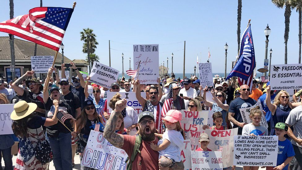 Image shows protesters converged on Huntington Beach in May