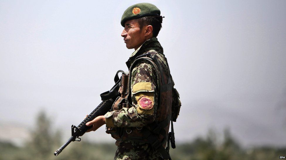 A member of the Afghan security forces stands guard on a roadside as security is increased following reports of the death of Mullah Omar, the leader of the Afghan Taliban, in Kabul, Afghanistan, 29 July 2015