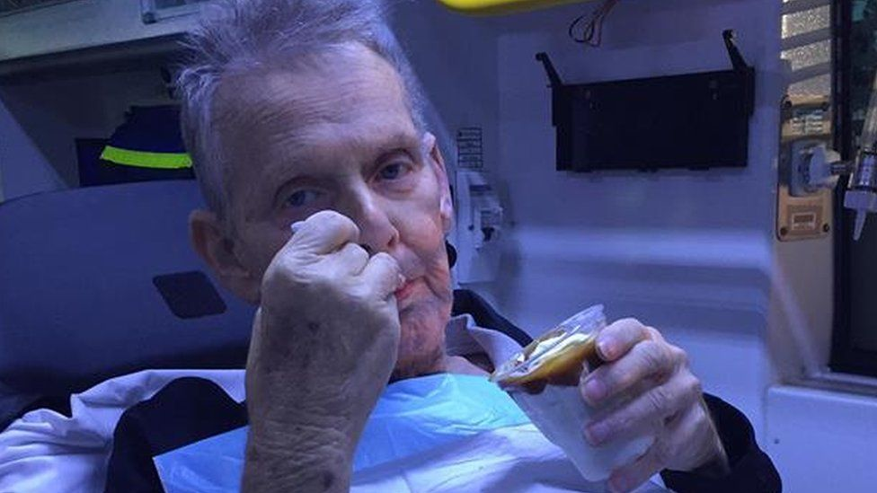 Ron McCartney eating the ice cream in the ambulance