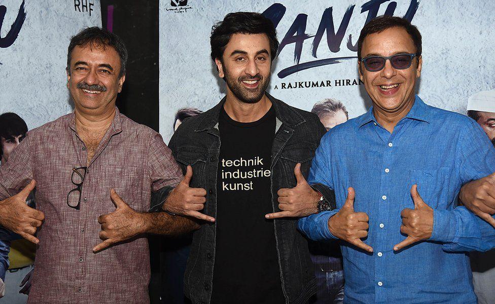 Actor Ranbir Kapoor (C) with director Rajkumar Hirani (L) producer Vidhu Vinod Chopra (R) in Mumbai for the film's promotion.