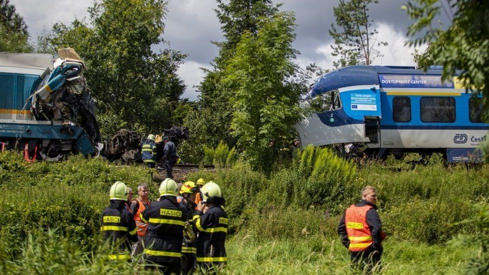 Rescuers at the scene of a train crash in village of Milavce, Czech Republic