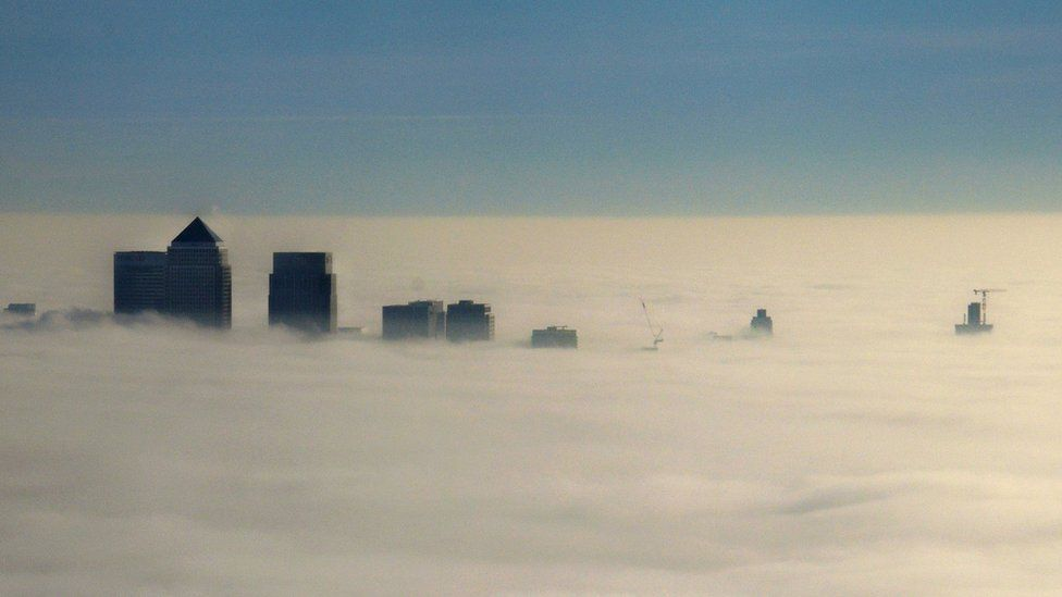 Canary Wharf peeping out of the fog