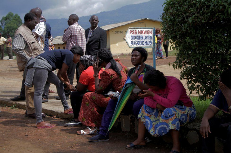 Parents await for news of their children at a school where 79 pupils were kidnapped in Bamenda, Cameroon November 6, 2018.