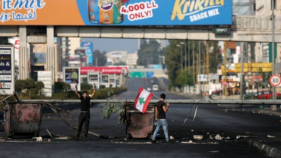 Anti-government protesters block a main road in northern Beirut, Lebanon (21 October 2019)