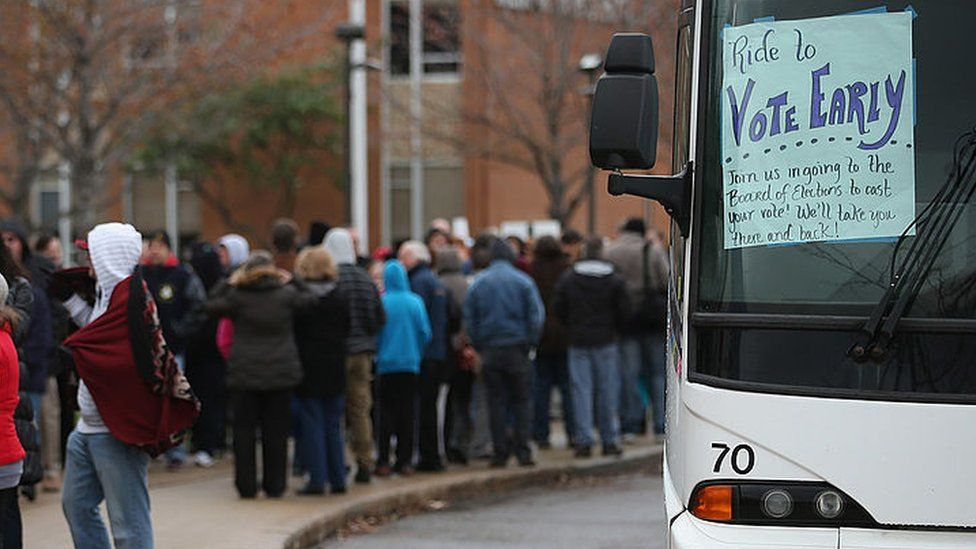 Charter bus waiting to take people to vote in 2012