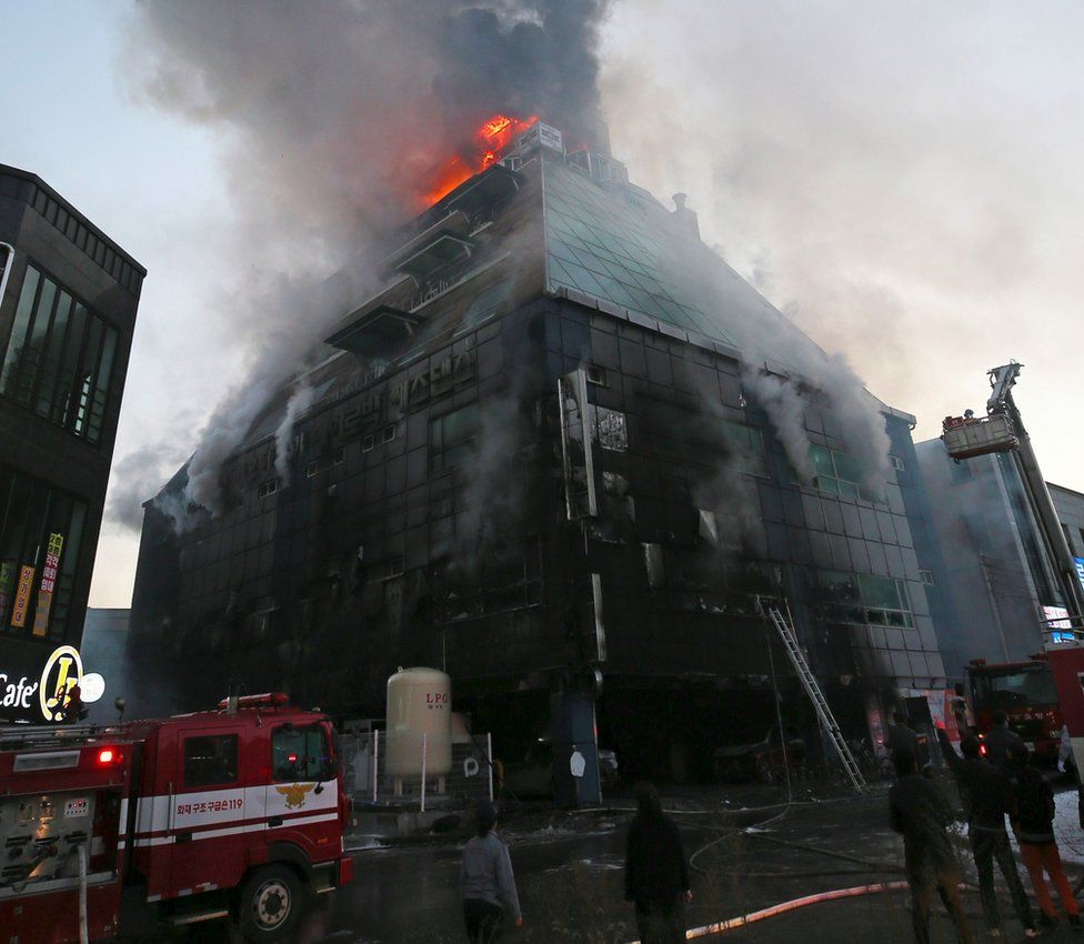 Flames and smoke billow from an eight-storey building after a fire broke out in Jecheon, 120km southeast of Seoul, 21 December 2017