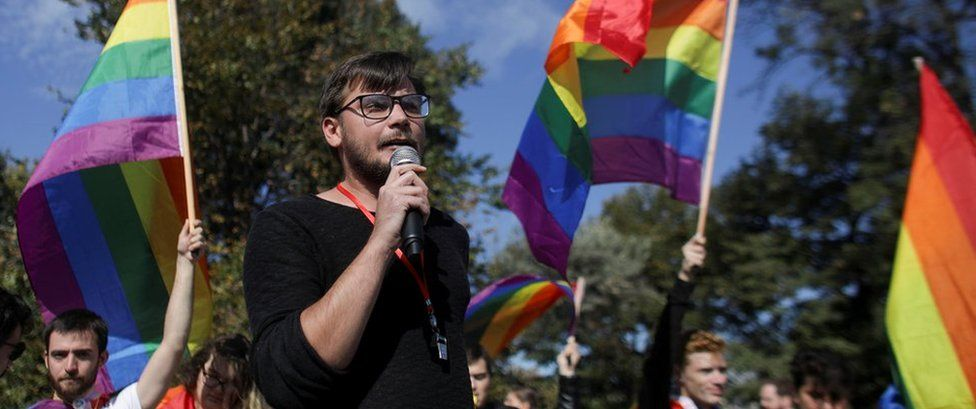 Vlad Viski of LGBT rights group Mozaiq delivers a speech during a protest against the referendum regarding proposed changes to the constitution that would prevent future recognition of same-sex marriages, in Bucharest, Romania, September 30, 2018.