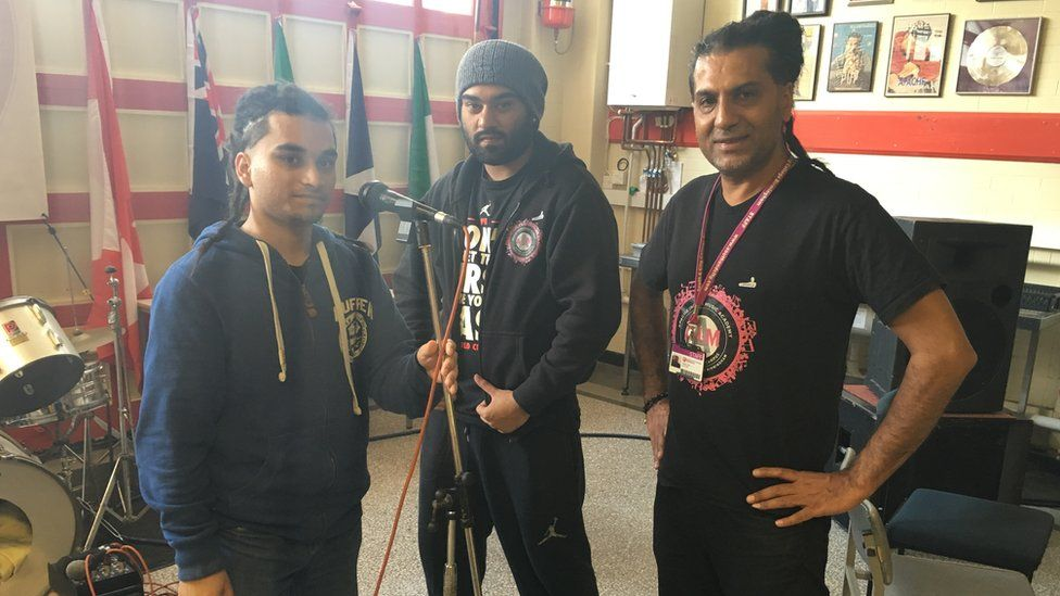 Apache Indian with his music academy students