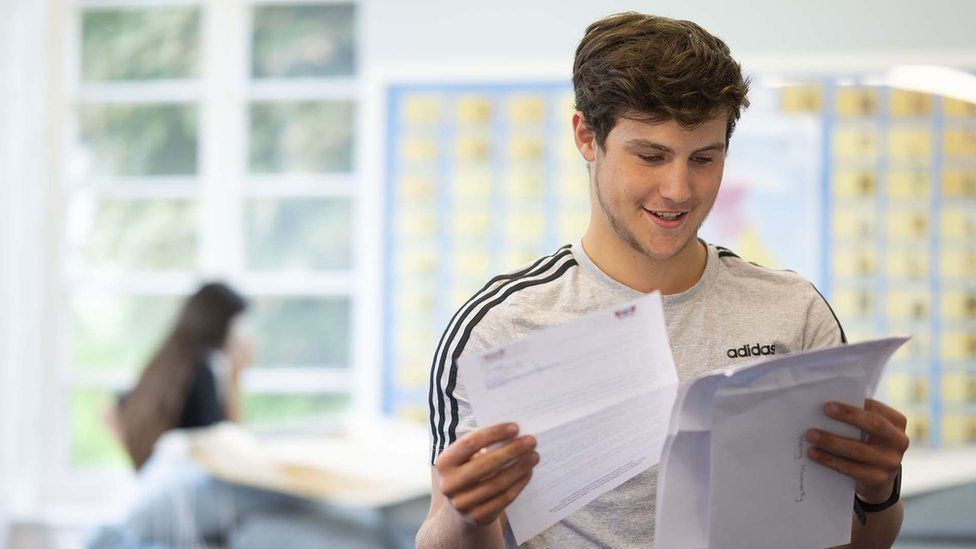 Boy looks at his results