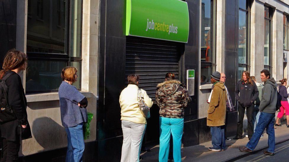 people queue outside jobcentre
