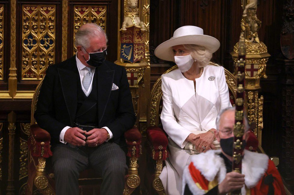 The Prince of Wales and the Duchess of Cornwall seen as Queen Elizabeth II delivers a speech from the throne in House of Lords at the Palace of Westminster in Londo