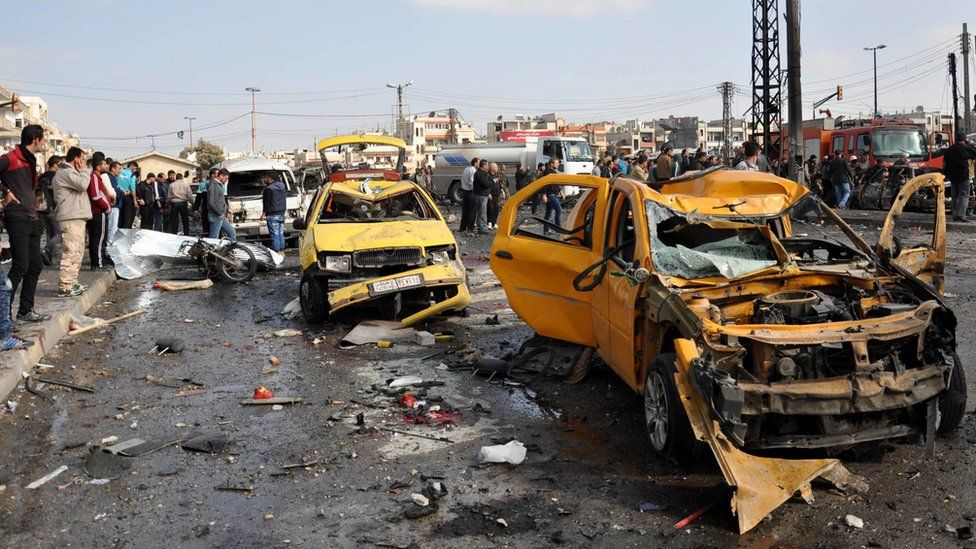 Wrecked cars in Homs, Syria following a double car bombing
