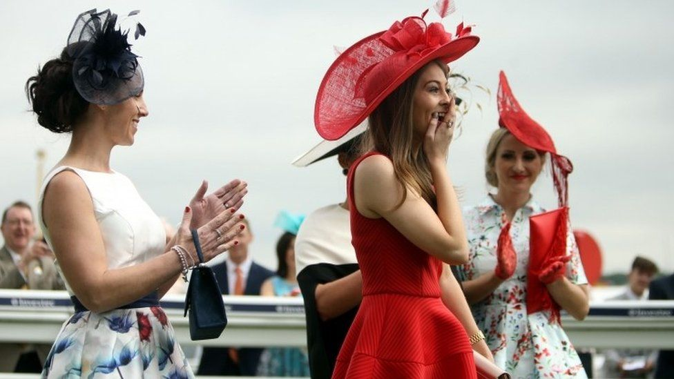 Katherine Wheatley from Surrey (second right) wins the Investec Ladies Style Award on Ladies Day during the 2016 Investec Epsom Derby Festival