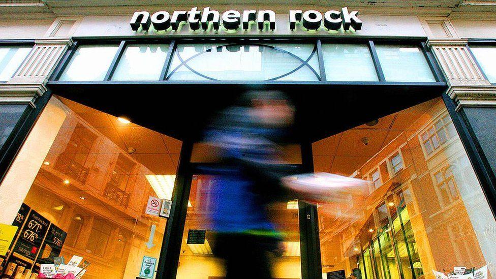 Man walks past a Northern Rock branch