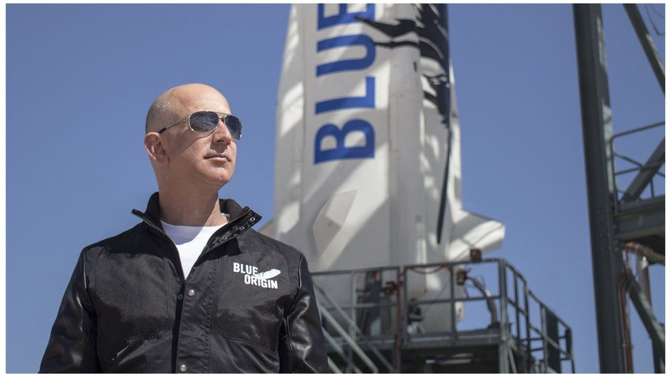 "This April 24, 2015 handout photograph obtained courtesy of Blue Origin shows Jeff Bezos, founder of Blue Origin, at New Shepard""s West Texas launch facility before the rocket""s maiden voyage."