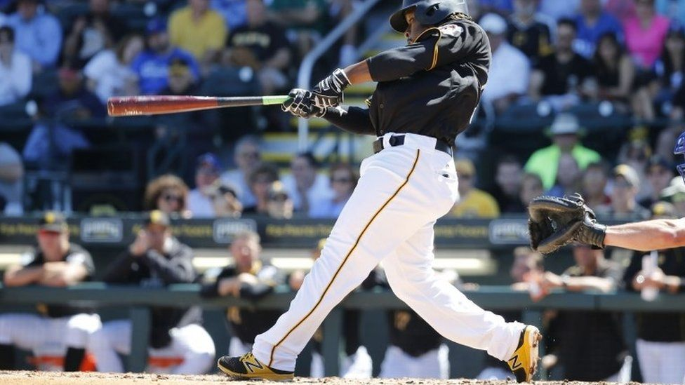Pittsburgh Pirates second baseman Gift Ngoepe (61) hits a RBI single during the fourth inning against the Toronto Blue Jays