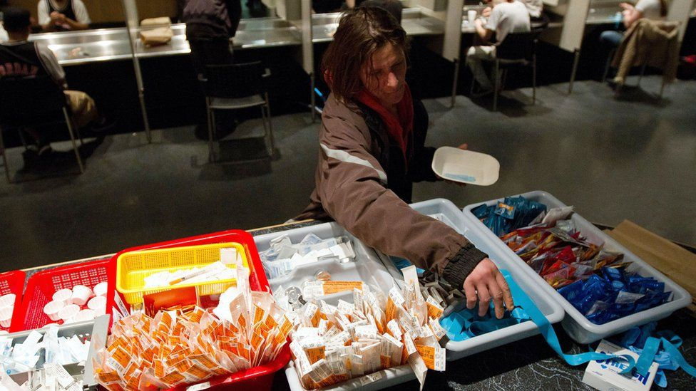 A client of the Insite supervised injection Center in Vancouver, Canada, collects her kit on May 3, 2011
