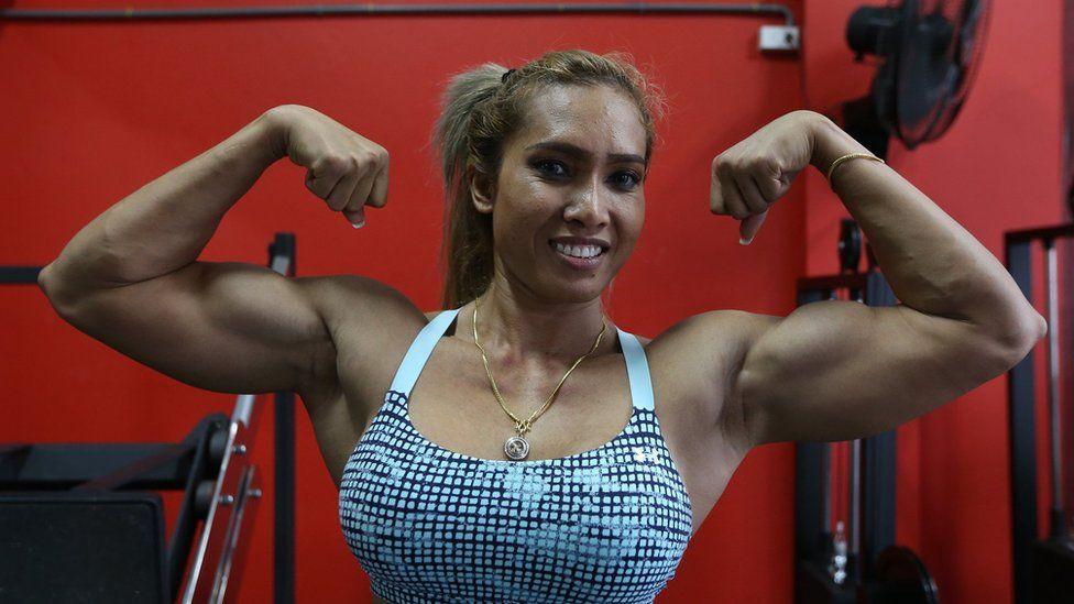 Penpraghai Tiangngok poses showing her muscles.