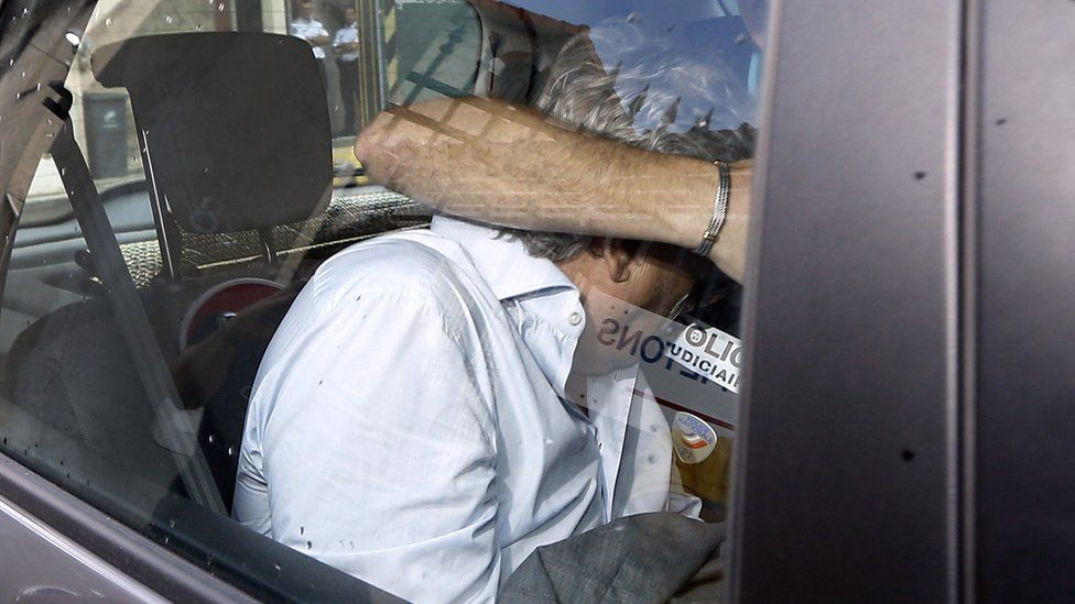Wojciech Janowski, the son-in-law of the 77-year-old heiress Helene Pastor, leaves a police station in Nice, southeastern France, on June 27, 2014