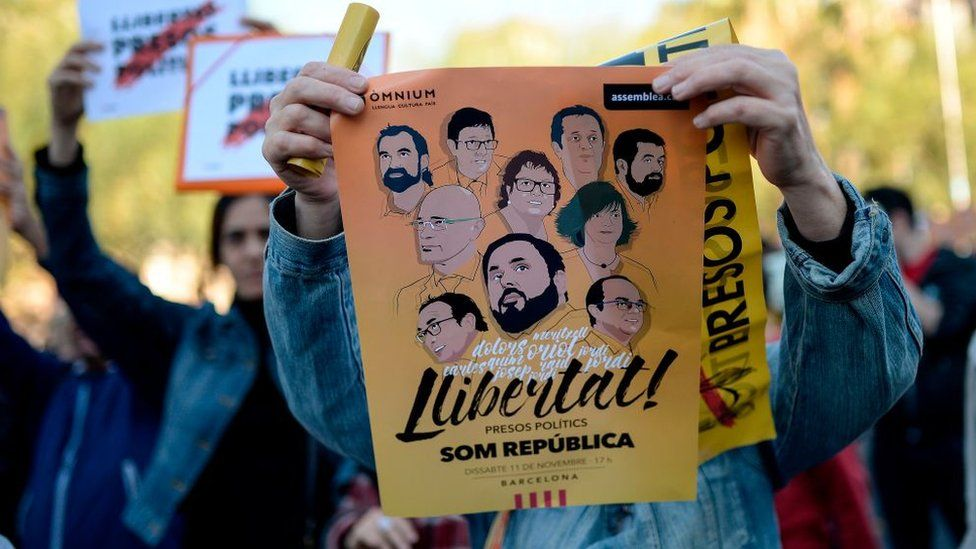A demonstrator holds up a poster demanding freedom for imprisoned pro-independence Catalan politicians during a demonstration called by students at the University of Barcelona in Barcelona on 5 November 2017