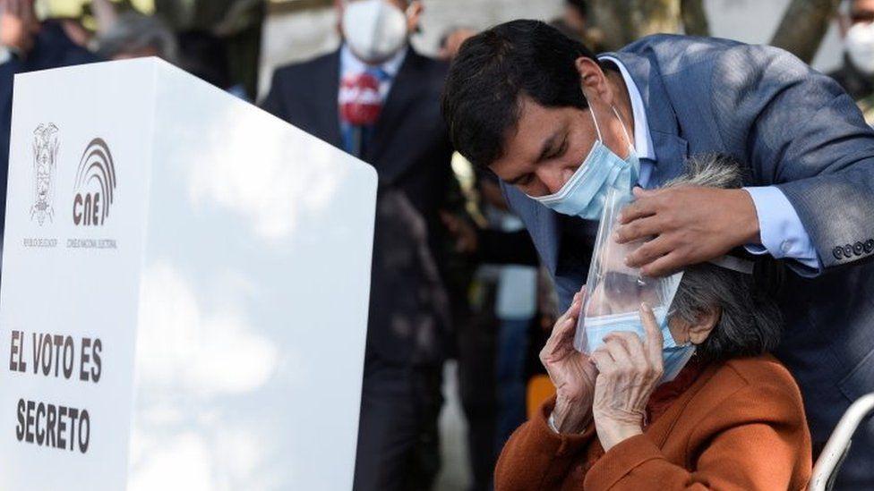 Andrés Arauz embraces his grandmother