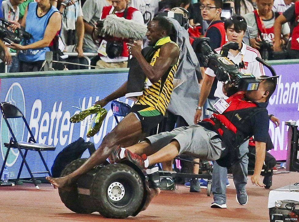 Usain Bolt is floored by a cameraman on a segway