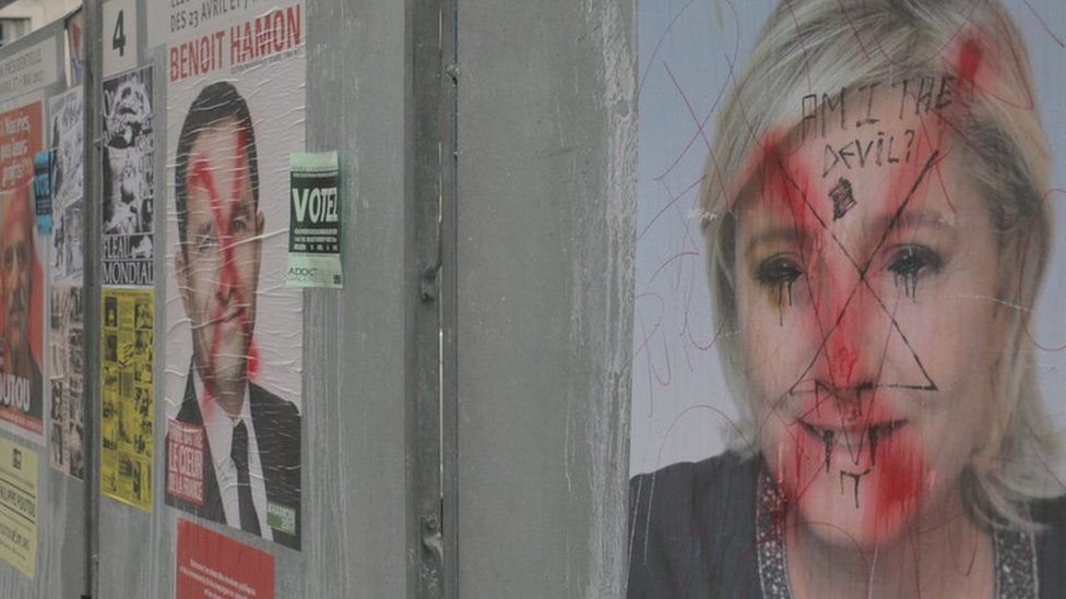 A vandalised poster of Marine Le Pen