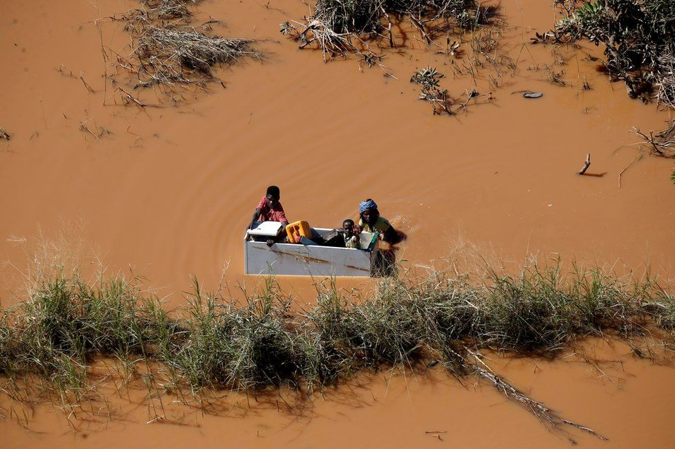 A child is transported on a fridge during floods after Cyclone Idai, in Buzi, outside Beira, Mozambique, 21 March 2019.