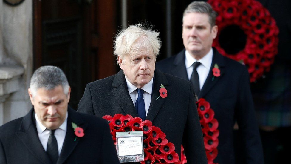 Prime Minister Boris Johnson carries a poppy wreath during a National Service of Remembrance at the Cenotaph in Westminster