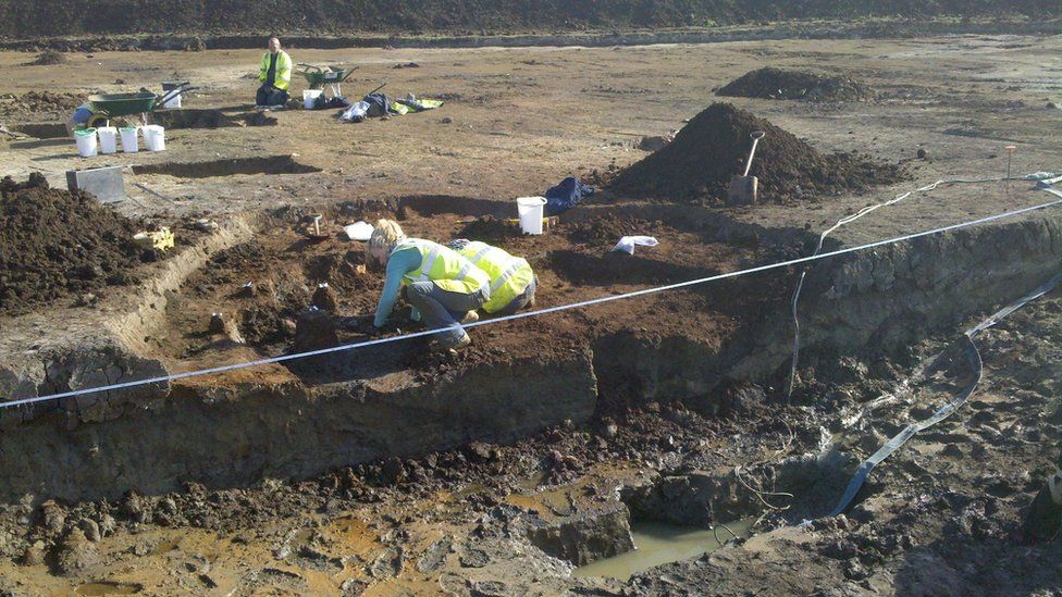 Archaeologists working in the waterlogged pit